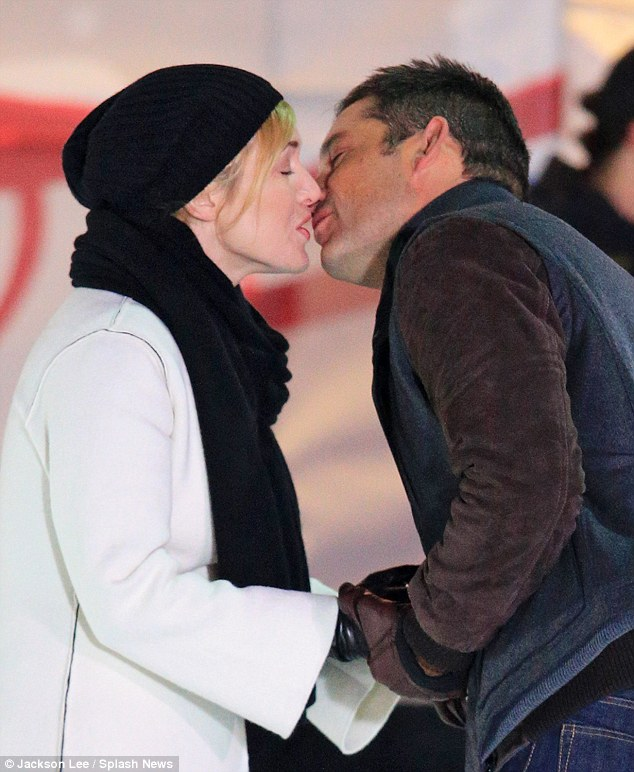 Kate Winslet kisses Enrique Murciano while Filming on a Skating Rink